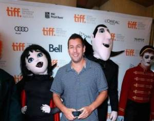 To his credit, Sandler is the least terrifying thing in this picture. It's always the cosplayers...