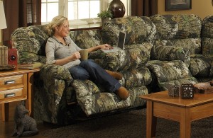 """Awkwardly uncomfortable on the camo-couch,"""